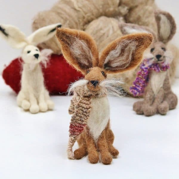 three needle felted hares